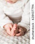 baby girl is holding her leg.... | Shutterstock . vector #628437794