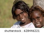 Small photo of NORTHERN TERRITORY, AUSTRALIA - JUNE 03 2009: A portrait of two beautiful young aboriginal kids with smiling faces.