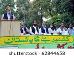 Small photo of ISLAMABAD, PAKISTAN - OCT 11: Jamat-e-Islami (JI) Ameer, Syed Munawar Hassan, addresses Yakjehti (Solidarity) Kashmir rally on October 11, 2010 in Islamabad, Pakistan.