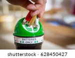 man putting used batteries into ... | Shutterstock . vector #628450427