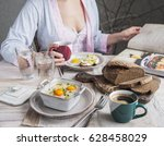 a woman is having breakfast at... | Shutterstock . vector #628458029