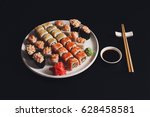 Sushi And Rolls Set On Black...