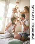 family having funny pillow... | Shutterstock . vector #628463651
