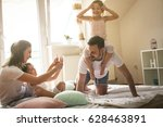 family playing with their two... | Shutterstock . vector #628463891