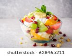 fresh fruit salad with yogurt... | Shutterstock . vector #628465211