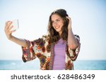 young woman smiling while... | Shutterstock . vector #628486349