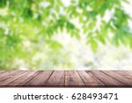 empty wooden table with blurred ... | Shutterstock . vector #628493471