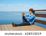 happy woman is sitting on a... | Shutterstock . vector #628513019