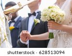 bridal couple holding hands at... | Shutterstock . vector #628513094