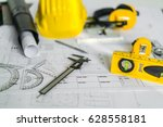 construction plans with helmet... | Shutterstock . vector #628558181