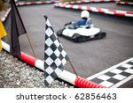 flags and cars on carting track | Shutterstock . vector #62856463
