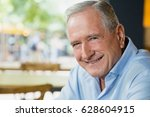 portrait of happy senior man... | Shutterstock . vector #628604915