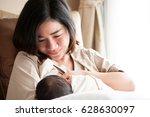 Mother Breastfeeding Her...