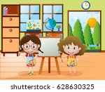 two girls  with paintbrush and... | Shutterstock .eps vector #628630325