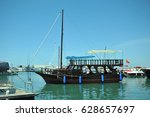 wooden sailboat at the pier | Shutterstock . vector #628657697