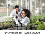 two young smiling engineers... | Shutterstock . vector #628660205