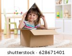kid girl playing with book in a ... | Shutterstock . vector #628671401