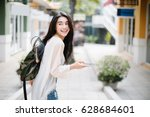 asia woman walking and using a... | Shutterstock . vector #628684601