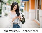 asia woman walking and using a... | Shutterstock . vector #628684604