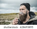 man smoking cigarette  young... | Shutterstock . vector #628693895