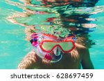 funny child wearing diver mask... | Shutterstock . vector #628697459