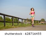 fit woman running at park in... | Shutterstock . vector #628716455