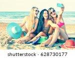 happy young women taking selfie ... | Shutterstock . vector #628730177