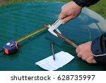 man measures metal rod diameter ... | Shutterstock . vector #628735997
