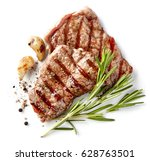 grilled beef steak isolated on... | Shutterstock . vector #628763501