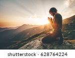 man praying alone at sunset... | Shutterstock . vector #628764224