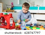 boy play with colored cubes | Shutterstock . vector #628767797