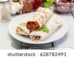 mexican burritos wraps with... | Shutterstock . vector #628782491