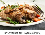pork rolls and vegetables on a... | Shutterstock . vector #628782497