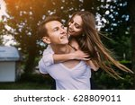 young man carries his... | Shutterstock . vector #628809011