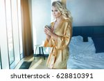 blonde elegant woman drinking... | Shutterstock . vector #628810391