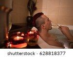 young handsome man enjoys... | Shutterstock . vector #628818377