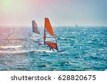 Windsurfer Surfing The Wind On...