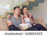 young handsome couple enjoying... | Shutterstock . vector #628821935