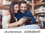 dating in library. young couple ... | Shutterstock . vector #628838645