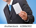 Businessman holding blank business card - stock photo