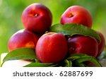 Red peachs. - stock photo