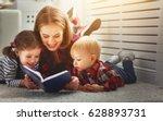mother reads book to children... | Shutterstock . vector #628893731