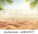 Sand With Blurred Palm And...