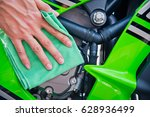hand with man cleaning... | Shutterstock . vector #628936499