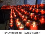 multiple candles lit in red... | Shutterstock . vector #628946054