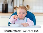 little baby eating | Shutterstock . vector #628971155
