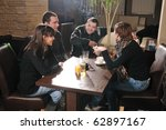 young people sitting in cafe... | Shutterstock . vector #62897167