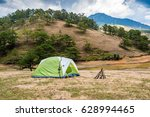 camping and tent near the pine... | Shutterstock . vector #628994465
