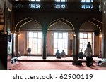 Moslems performing their prayer in the gorgeous Blue Mosque in Istanbul, Turkey - stock photo