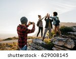 young man taking pictures of... | Shutterstock . vector #629008145
